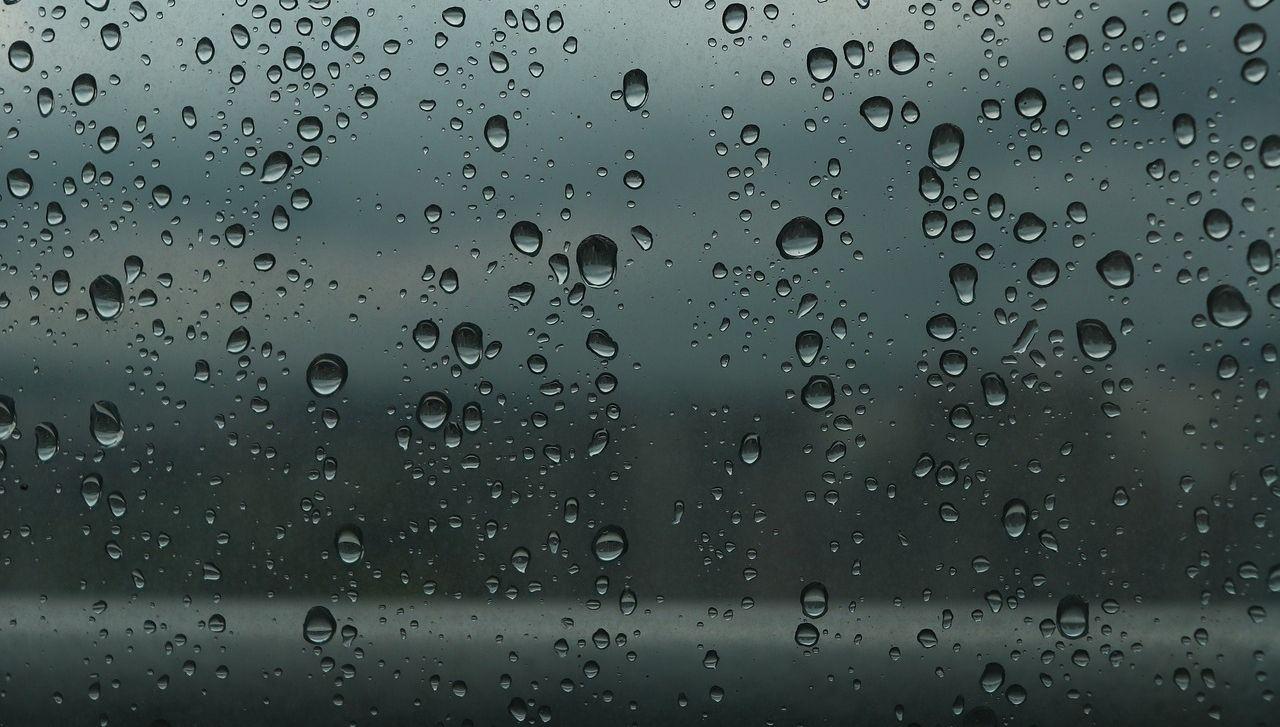 Rain drops trickling from window