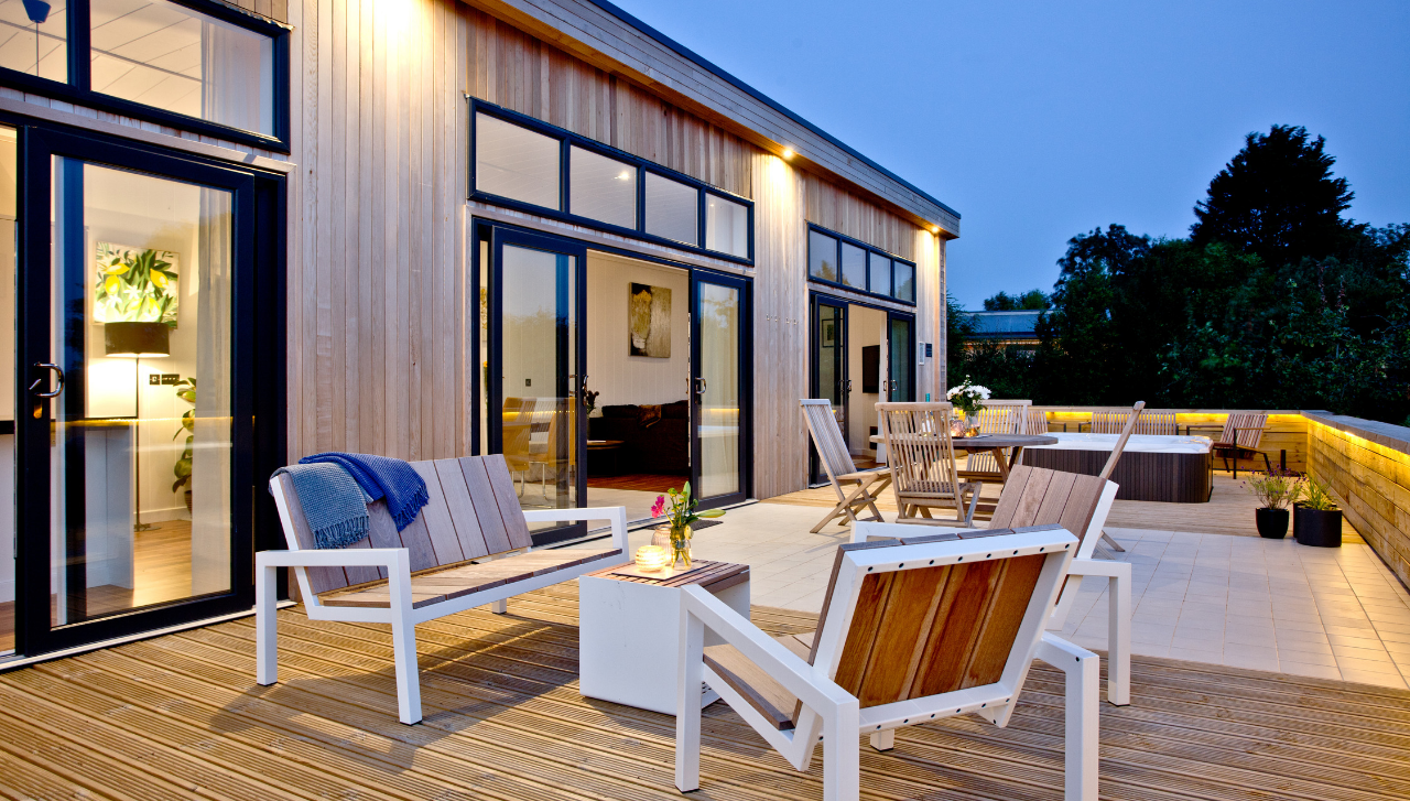 Burrington decking with sun loungers and hot tub